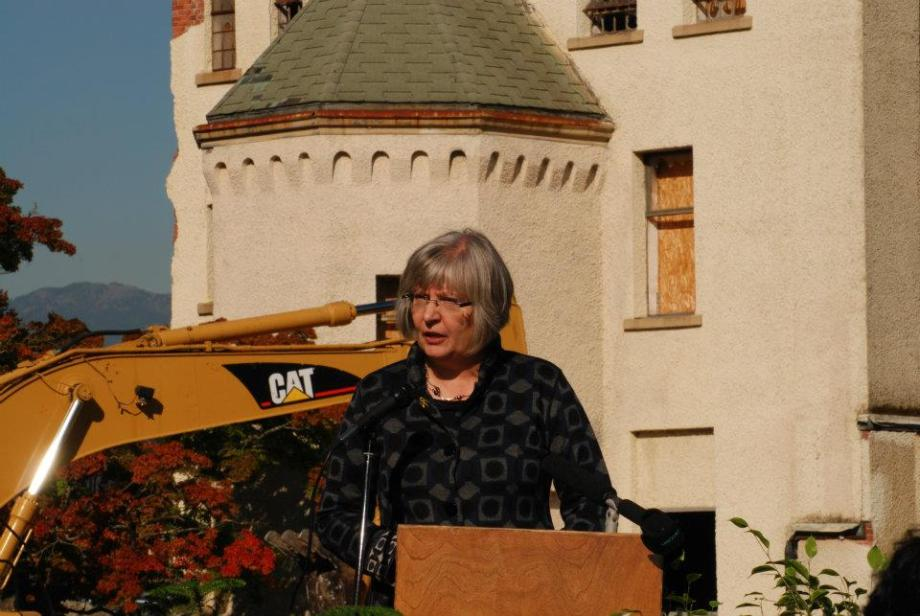 Faith Bodnar in front of the Centre Block Tower at Woodlands as it is being demolished
