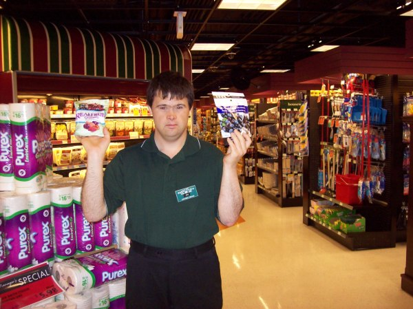 Jai holding up some of the things they sell in the IGA